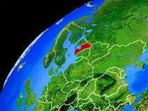 Lettland auf Erde vom Raum stockbild