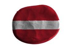 Lettland flagga, flaggalera på vit bakgrund Royaltyfria Foton