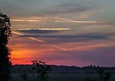 Lettland natur, solnedgång, Auce royaltyfria foton