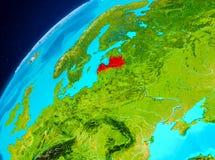 Lettland på jord från utrymme Fotografering för Bildbyråer