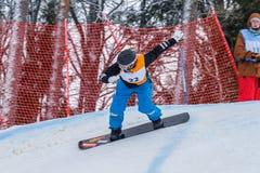 Lettland stad Cesis, vinter, Snowboardmästerskap, snowboarder, Royaltyfri Fotografi