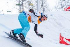 Lettland stad Cesis, vinter, Snowboardmästerskap, snowboarder, Royaltyfria Bilder