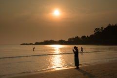 Lettore al tramonto Fotografie Stock