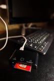 Lettore di schede tappato al computer nero Fotografie Stock