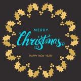 Lettrage bleu de main de Joyeux Noël avec la brindille d'or du houx illustration stock