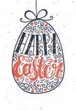 Lettrage d'aspiration de main Joyeuses Pâques Photos libres de droits