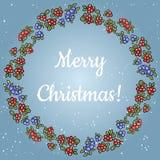 Lettrage de Joyeux Noël dans une guirlande d'ornement coloré de baies rouges et bleues illustration stock
