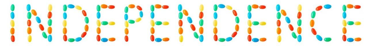 Lettrage de l'indépendance fait de sucreries multicolores Image libre de droits