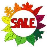 Lettrage de vente sur le fond coloré de feuilles d'automne Image stock