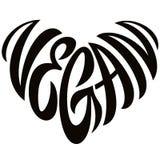 Lettrage de Word de Vegan d'amour sous forme d'emblème de coeur photographie stock libre de droits