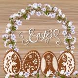Lettrage heureux de Pâques, pain d'épice sous forme d'oeufs Vacances de ressort, fond de Pâques Image libre de droits