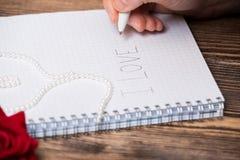 Lettre d'amour dans le cahier Photos stock