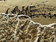 Lettre d'AMOUR sur le sable Photo stock