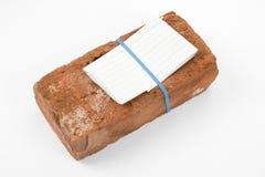 Lettre de brique rouge et de menace photographie stock libre de droits