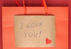 Lettre de confession jointe en annexe au sac de papier Image libre de droits