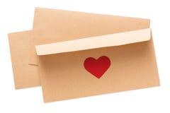 Lettre de Saint Valentin dans l'enveloppe d'isolement sur le fond blanc Photographie stock libre de droits