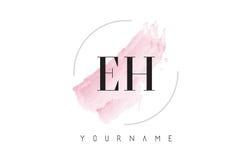 Lettre Logo Design d'aquarelle du potentiel d'oxydation-réduction E H avec le modèle circulaire de brosse Photographie stock libre de droits