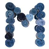 Lettre M faite de petit pain de jeans Image libre de droits
