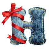Lettre magique d'alphabet de jeans de vacances avec le ruban rouge Image stock