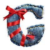 Lettre magique d'alphabet de jeans de vacances avec le ruban rouge Photo stock