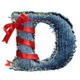 Lettre magique d'alphabet de jeans de vacances avec le ruban rouge Images stock