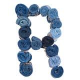 Lettre R faite de petit pain de jeans Images stock
