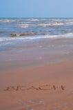 Lettre sur la plage sous la lucarne Image libre de droits
