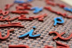 Lettres bleues et rouges aléatoires Photos libres de droits