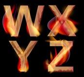 Lettres brûlantes d'alphabet, WXYZ Photographie stock