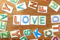 Lettres colorées écrites comme amour Photos stock