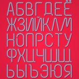 Lettres cyrilliques au néon bleues sur un fond rouge Image libre de droits