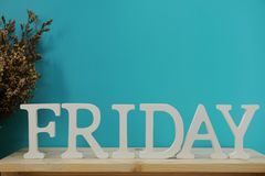 Lettres décoratives de mot de vendredi sur le fond bleu Images libres de droits