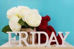 Lettres décoratives de mot de vendredi sur le fond bleu Photos libres de droits