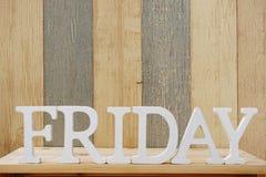 Lettres décoratives de mot de vendredi sur le fond en bois Photos libres de droits