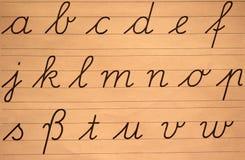 Lettres d'écriture, alphabet, sur une plaquette de vieille école photos libres de droits