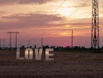Lettres d'amour de photo sur le fond de coucher du soleil Images libres de droits