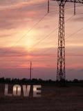 Lettres d'amour de photo sur le fond de coucher du soleil Photos libres de droits