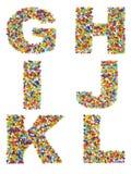 Lettres de l'alphabet G à L faits à partir du bea en verre coloré Photo stock