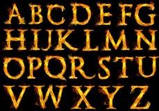 Lettres de l'alphabet sur le feu Photographie stock libre de droits