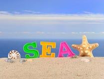 Lettres de mer sur un sable de plage Image stock