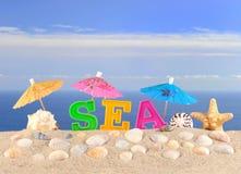 Lettres de mer sur un sable de plage Image libre de droits