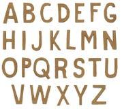 Lettres de papier déchirées d'alphabet Photographie stock libre de droits