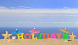 Lettres de vacances sur un sable de plage Image libre de droits