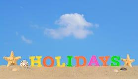 Lettres de vacances sur un sable de plage Photo stock
