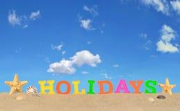 Lettres de vacances sur un sable de plage Photographie stock