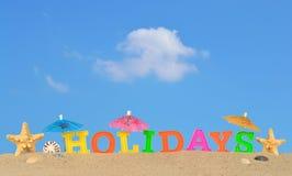 Lettres de vacances sur un sable de plage Photo libre de droits