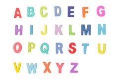 Lettres en bois colorées d'alphabet d'isolement sur le fond blanc Image libre de droits