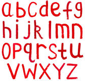 Lettres minuscules anglaises écrites par la peinture rouge Images stock