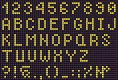 Lettres numériques jaunes de LED pour le texte, police d'affichage Photos libres de droits