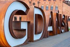 Lettres rouillées en métal de Danzig, Pologne photo stock